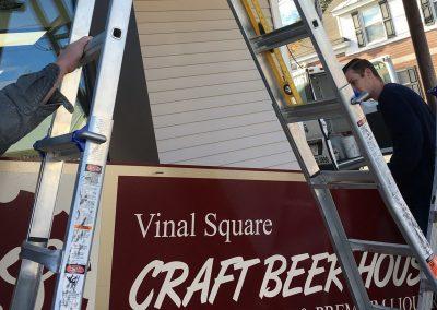 Installing Vinal Square Craft Beef Sign