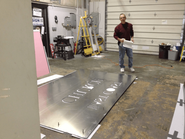 Nick working on assembly of the sign
