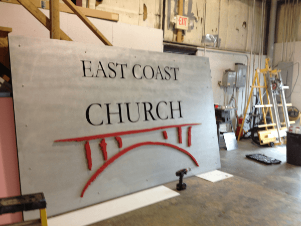 Partially Assembled Sign with Dimensional Letters Applied